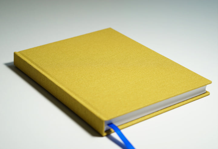yellow linen fabric notebook lying flat
