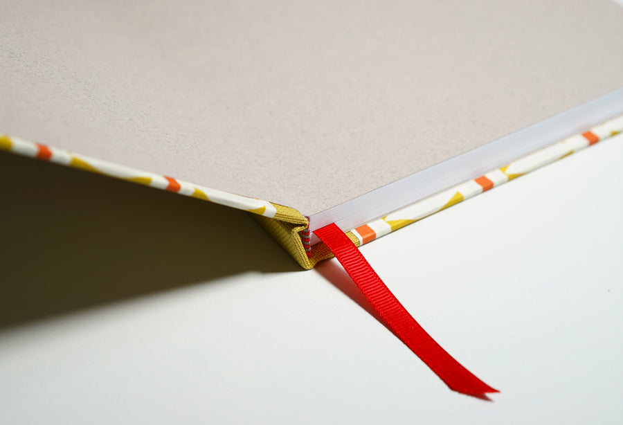 open yellow patterned notebook with red accents