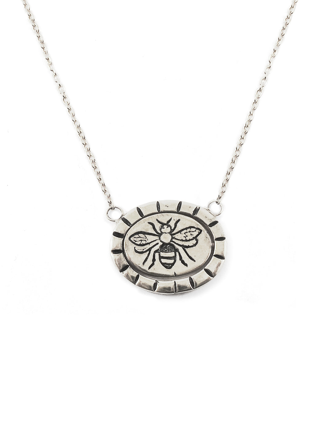Hunt Of Hounds Bee Mine Necklace in silver. Spinning pendant necklace with bee image and the word mine on reverse. Unisex.