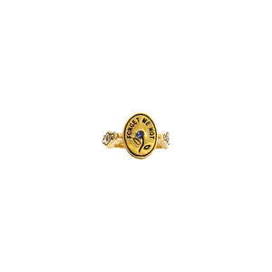 Hunt Of Hounds Forget Me Not Ring. Text surrounding a flower set with sapphire.