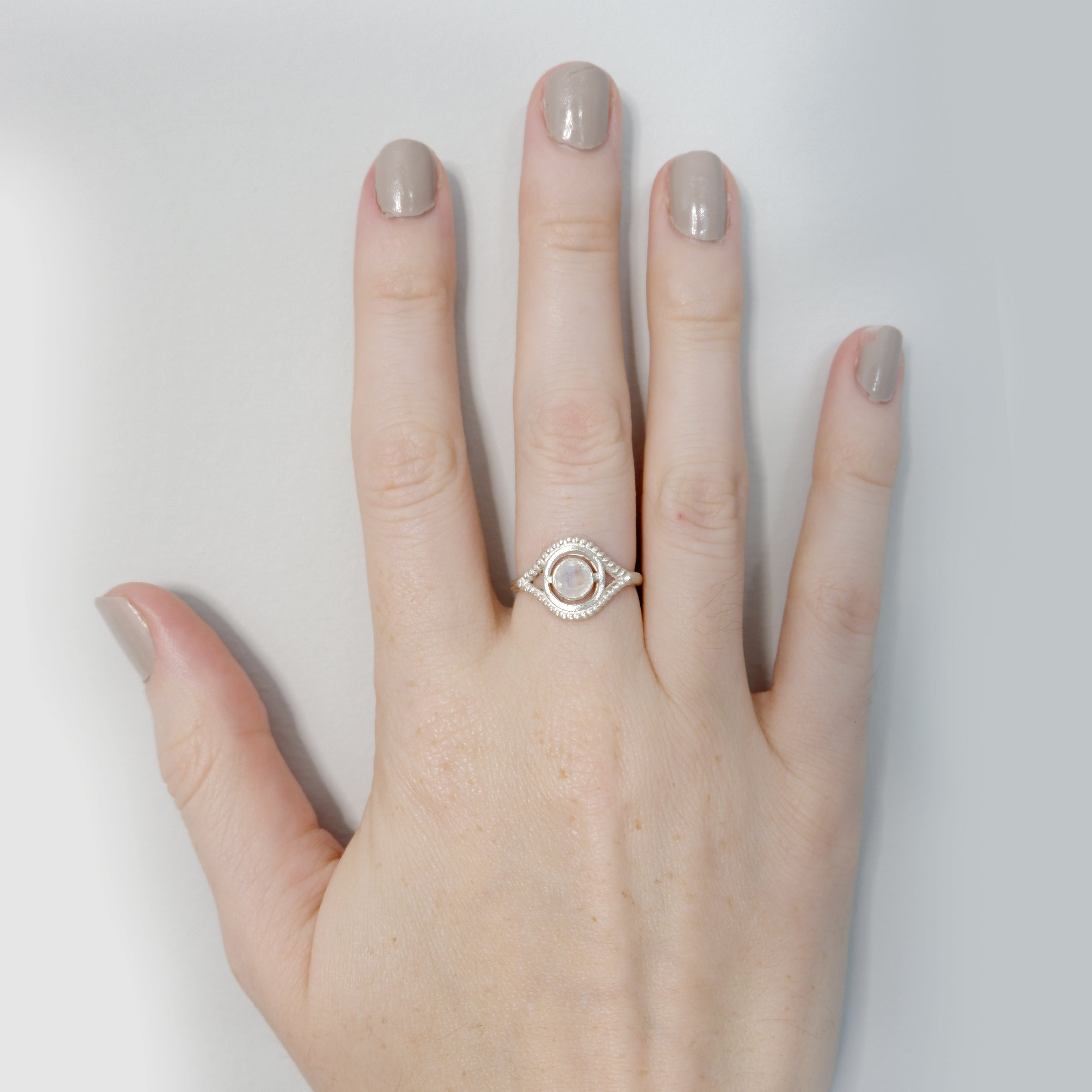 Hunt Of Hounds Nyx Ring. Eye ocular shape with moonstone. On model.