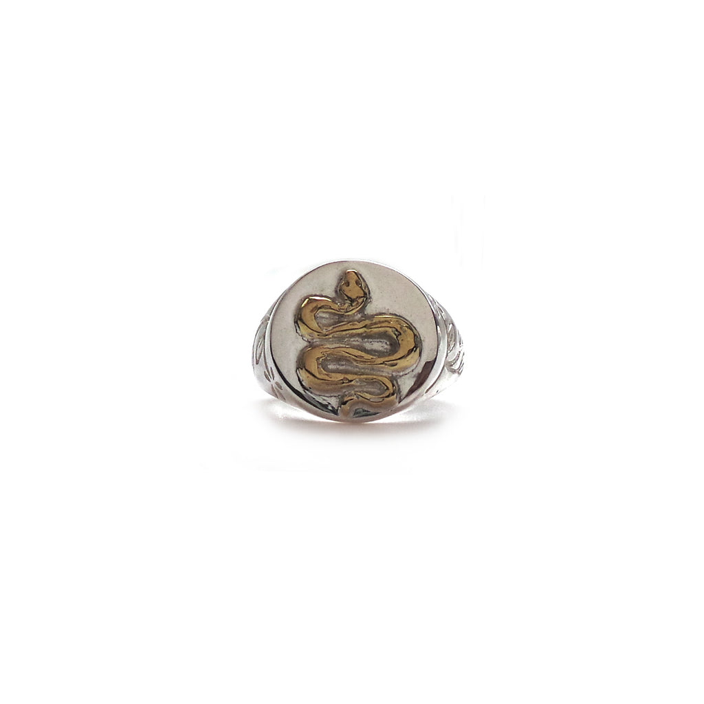 Hunt Of Hounds Serpent Signet Ring. Symbol of immortality and health. Brass detail on silver with botanical leaf motif.