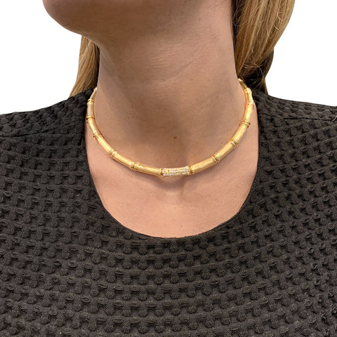"Collier Cartier, ""Bamboo"", en or jaune et diamants."