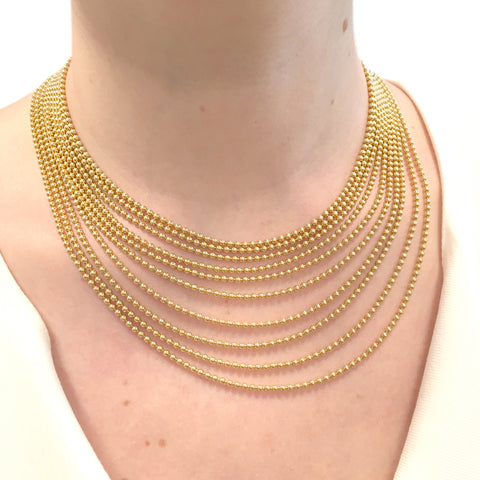 "Collier Cartier, ""Draperie"", en or jaune."