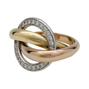 "Bague Cartier, ""Trinity Crash"", trois ors, diamants."