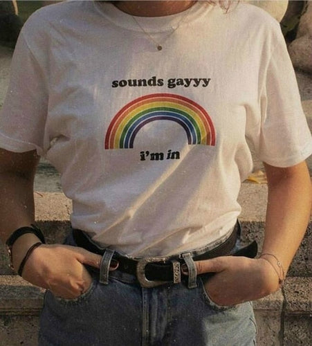 White t-shirt with a rainbow and the words