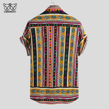 Load image into Gallery viewer, The back of a button up shirt with a yellow, pink and black southwestern print
