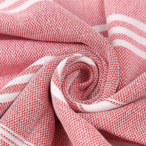 Red Turkish Towel displayed in a spiral
