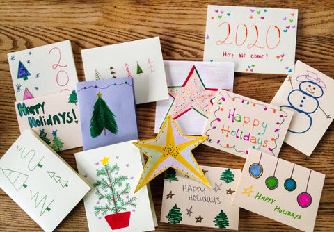 A variety of holiday cards on a wooden table