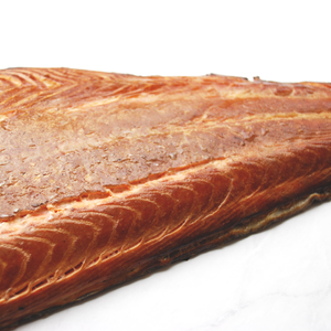 1kg side of hot smoked salmon on marble surface
