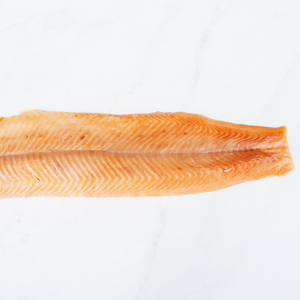 Load image into Gallery viewer, Hot smoked trout fillet on marble surface