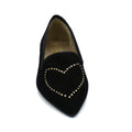 Black suede pointed toe flats from front angle