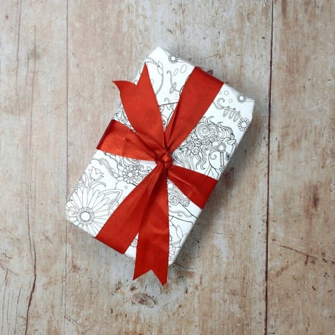 How to wrap Christmas presents in colouring book pages
