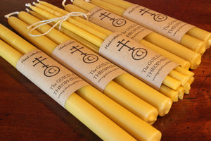 Pair of beeswax taper candles, 12 x 7/8 inch.