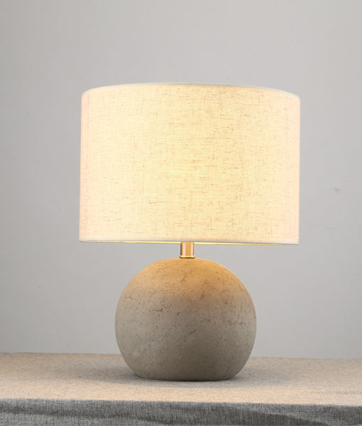 ROCA01: Interior table lamps. ES Cement Grey RND concrete base with flaxen cloth shade H430mm x OD300mm. CLA Lighting