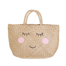 Load image into Gallery viewer, Shopping basket, made from natural seagrass.  This shopper has 2 simple handles and a smiley face design.  Size - L36 x W10 x H42 cm  Material - Straw