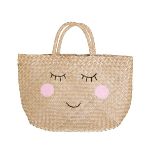 Shopping basket, made from natural seagrass.  This shopper has 2 simple handles and a smiley face design.  Size - L36 x W10 x H42 cm  Material - Straw