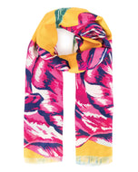 Beautiful yellow printed scarf by the brand Powder, that will brighten up a plain outfit. Can also be use as a sarong. It will come with a scarf ring and in a lovely gift bag. The perfect gift for a special lady in your life or a treat for yourself.  Size 100cm x 180cm  100% Polyester