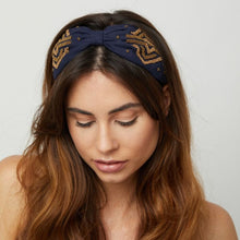Load image into Gallery viewer, Beautiful Navy headband with gold coloured beaded art deco design.  Features a knot at the centre to draw focus from the wide fit.    Size  - One size