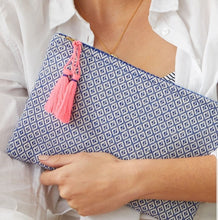 Load image into Gallery viewer, This clutch is made from woven cotton blend fabrics with handmade matching tassels and lined in a waterproof fabric, making it perfect to carry make up or take on holiday with your travel essentials.  Use as an evening clutch to brighten up a black outfit.  Colours are reversed on the back of the pouch   Size: 26.5 x 18 cm  Materials:  Cotton, Jute, Polyester & Acrylic