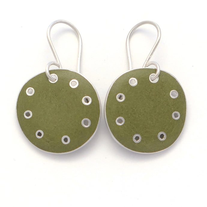Earrings, green enamel on silver with pierced dots on perimeter