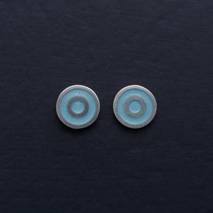 Small-flat-round-ear-studs-with-light-blue-Turquoise-coloured-enamel-in-the-centre