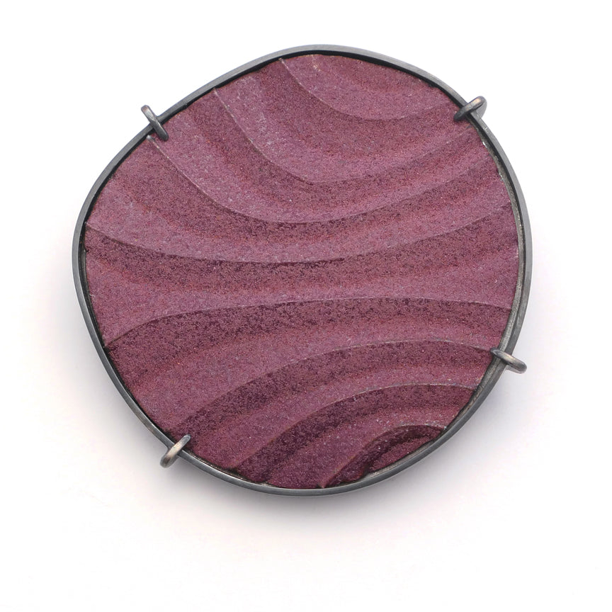 Brooch, finely textured enamelled surface in contoured lines,purple colour with