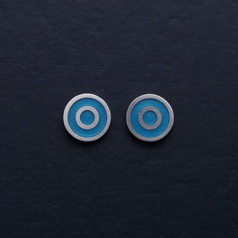 Small-flat-round-ear-studs-with-turquoise-blue-coloured-enamel-in-the-centre