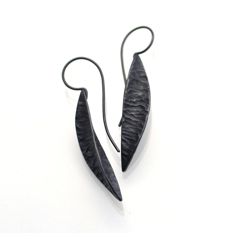 Solid sterling silver earrings. They are a charcoal black in colour, they have been oxidised. The earwire is long and elegant