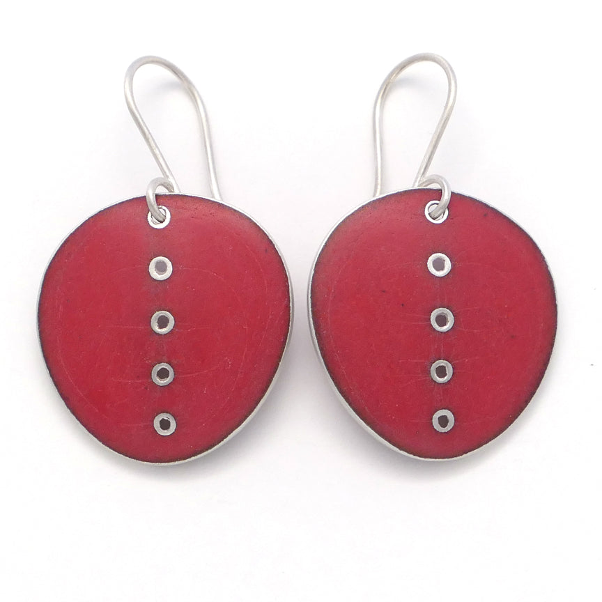 Large red enamelled earrings with line of pierced dots