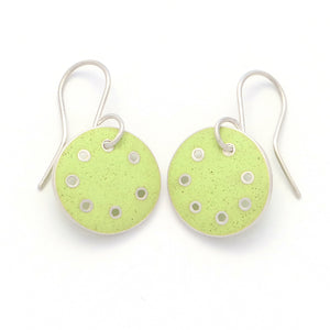 Small round earrings with lime-green enamel in silver with pierced dots on perimeter