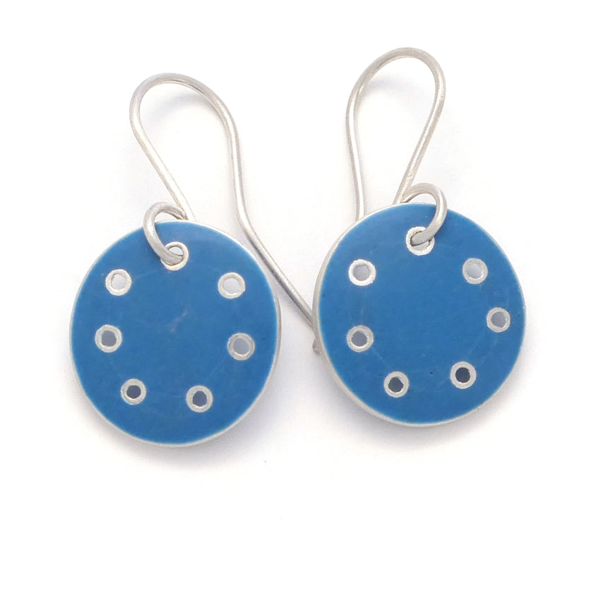Small round earrings in blue enamel and silver with pierced dots on perimeter