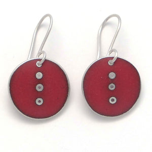Small round red enamel earrings with line of pierced dots