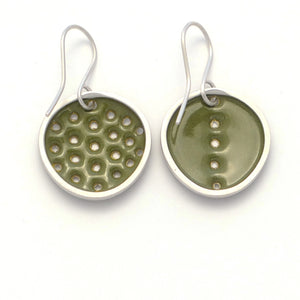 Green perforated earrings, odd-pair