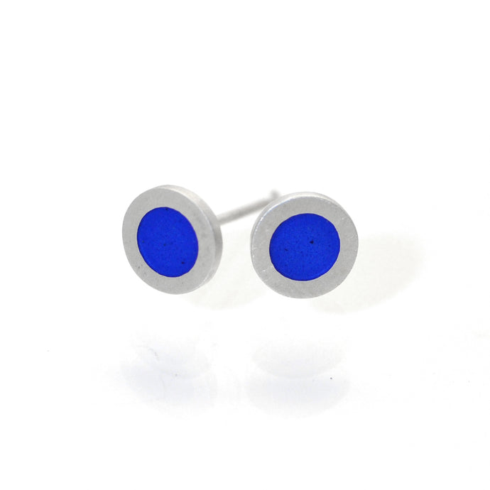 Small flat round ear studs with Mid blue coloured enamel in the centre