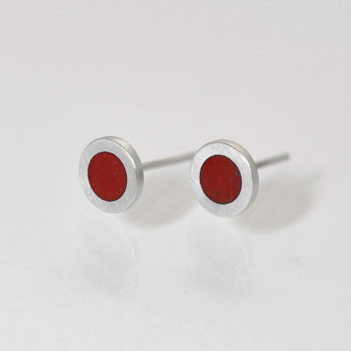 Small flat round ear studs with Red coloured enamel in the centre