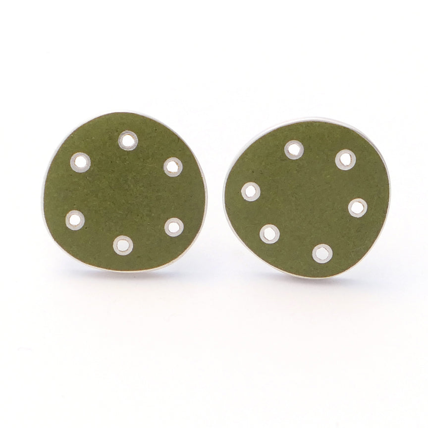 Stud earrings for pierced ears. Green enamel on silver with pierced dots on perimeter