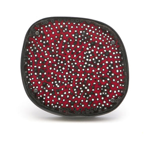 Brooch, perforated red enamel surface