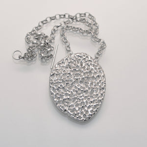 'Porous' perforated sterling silver pendant