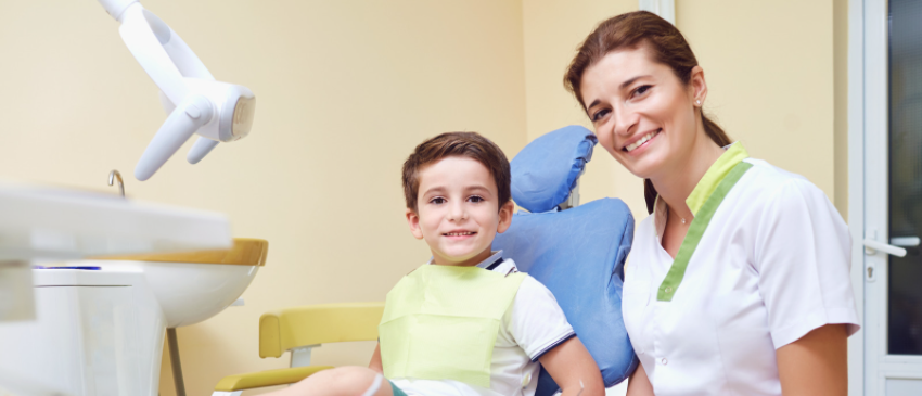 Child smiling at the dentist