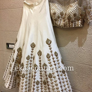 White and gold silk lehenga