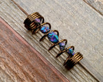 A top view of a Titanium Quartz Dread Bead.