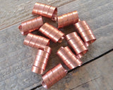 A close up top view of Copper Dread Beads Set of 10