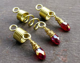 Red, Gold Loc Beads, Set of 3 displayed on painted wood background.