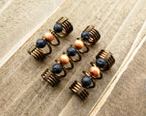 A top view of Diffuser Dread Bead Set of 3 on a wooden background.