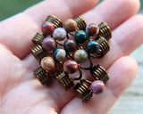 Set of 5 jasper dread beads in hand to show scale.