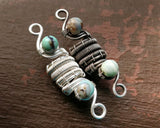 Silver, Terra Agate Dread Beads displayed on painted wood.
