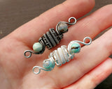 Silver, Terra Agate Dread Beads held in hand to show scale.