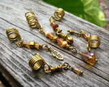 A side view of a Set of 5 Gold Amber Loc Beads.