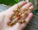 A top view of a Set of 5 Gold Amber Loc Beads in hand.